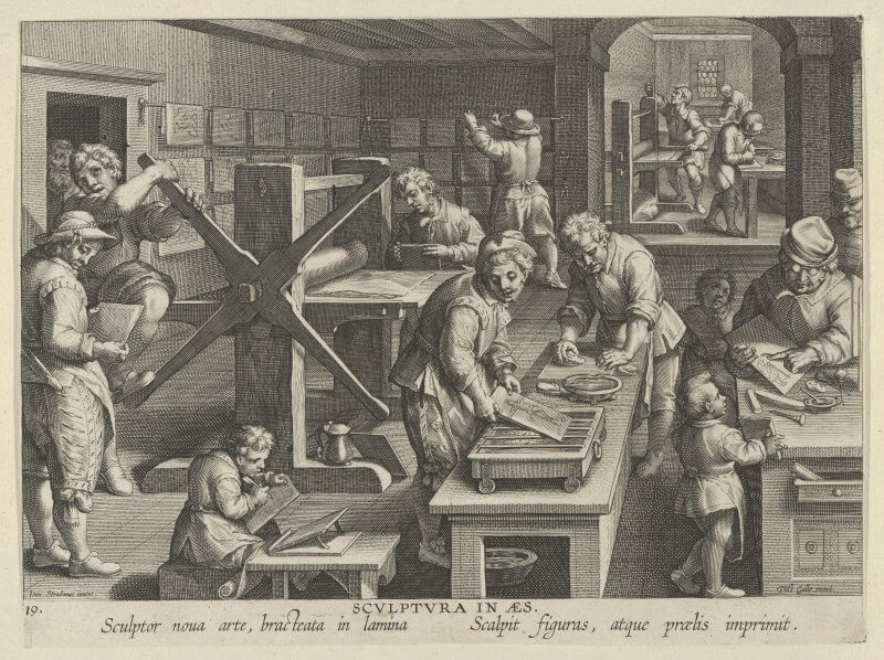 In this depiction of copper engraving, you can see the full range of activities involved in printing an engraving. In the background a sheet of copper is being flattened and prepared for engraving; in the lower right, boys are being taught how to use a burin to draw on a plate; in the middle men are inking and preparing a plate for printing; on the left, a man is turning the wheel of a rolling press to print a plate; and in the background, finished prints are being hung to dry.